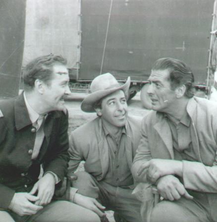 Actor, Fred Carson, Victor Mature during the filming of Escort West